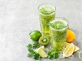 fat burning green fruit cocktail with kiwi, lemon, mint and parsley for slimming and healthy diet with space for a text